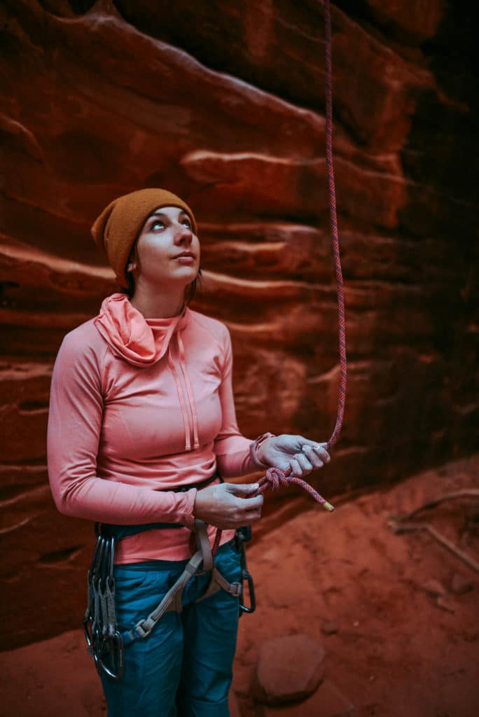 Gabi belaying while Sport Climbing at Namaste Wall in Kolob Canyon Zion national park utah photographed by the foxes photography adventure wedding photographers and outdoor lifestyle photography
