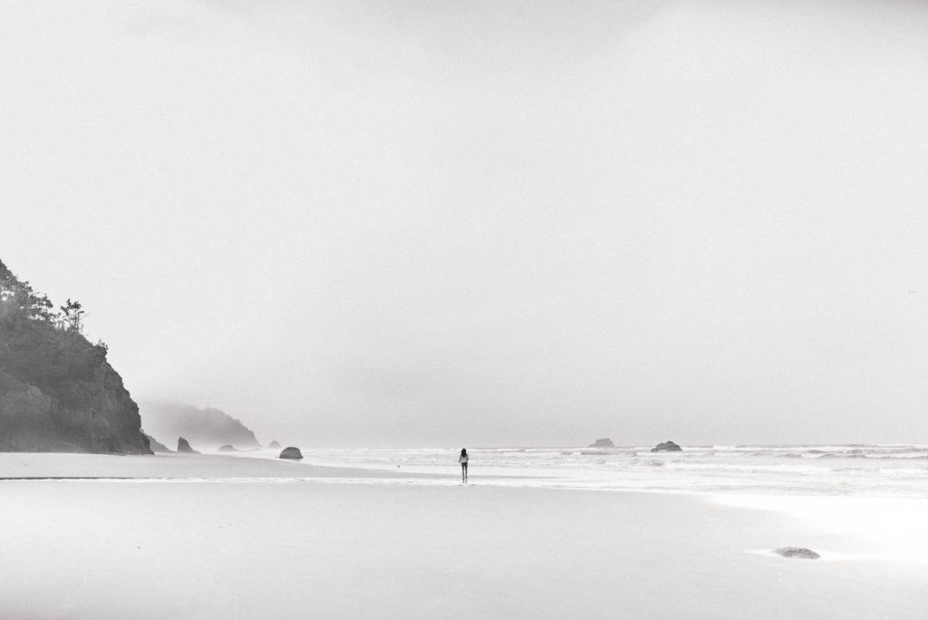 person walking on beach in the distance hug point oregon coast