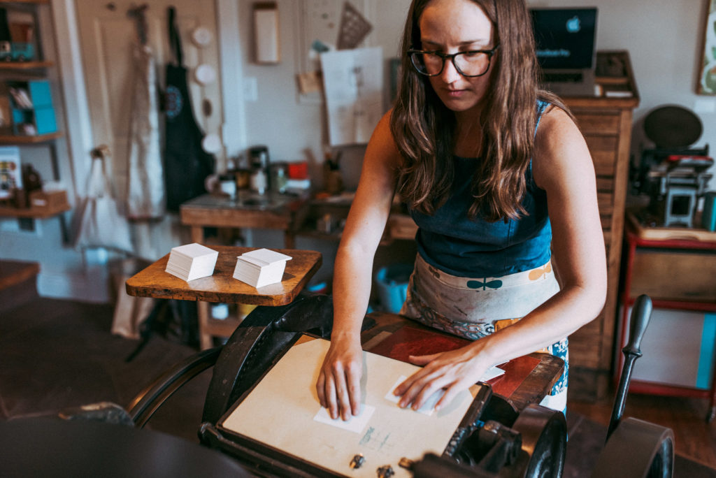 Sarah Ellen of Petite Press at work on the letterpress