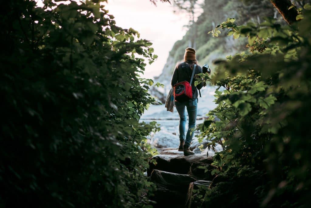 walking onto ruby beach olympic national park wedding photographers