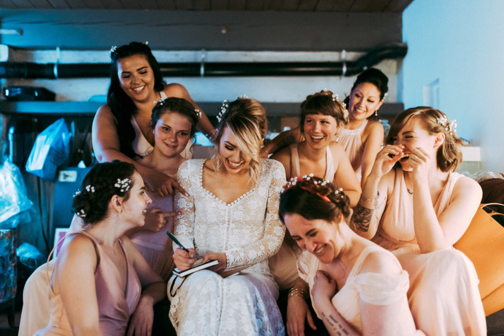 bridesmaids giggling around bride seattle wedding withinsodo sodo