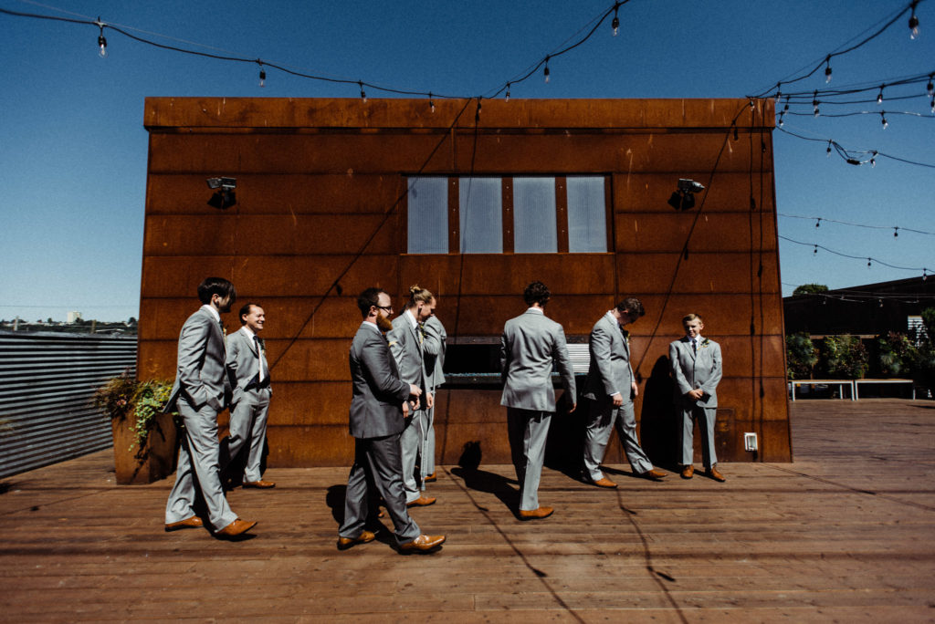 groomsmen withinsodo roof deck seattle wedding sodo