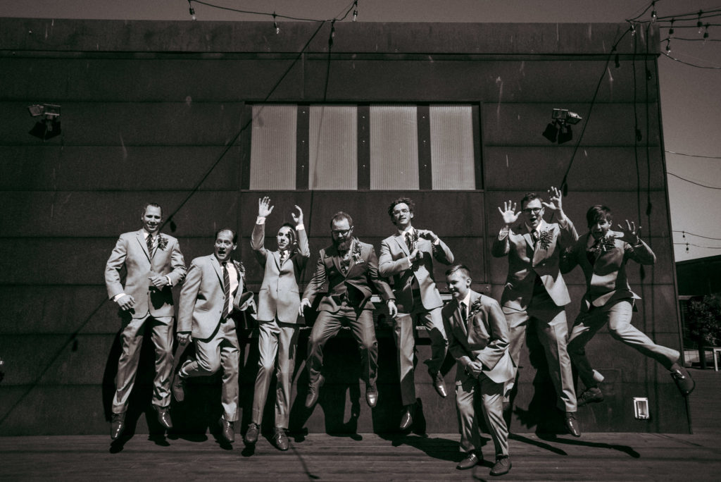 groomsmen jumping withinsodo roof deck seattle wedding sodo