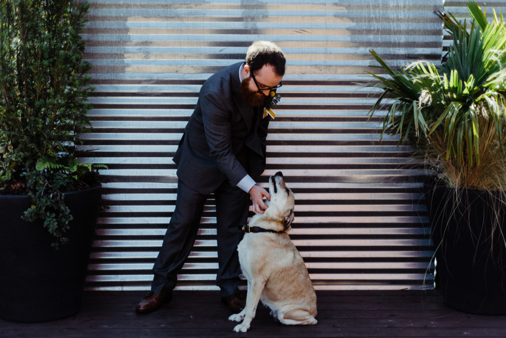 groom and dog withinsodo seattle wedding