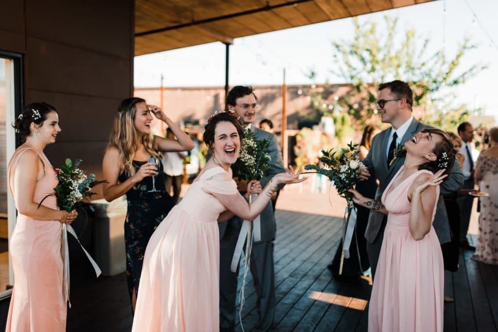 bridal party goofing withinsodo seattle wedding sodo