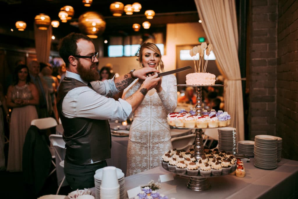 cutting cake at seattle wedding in sodo district