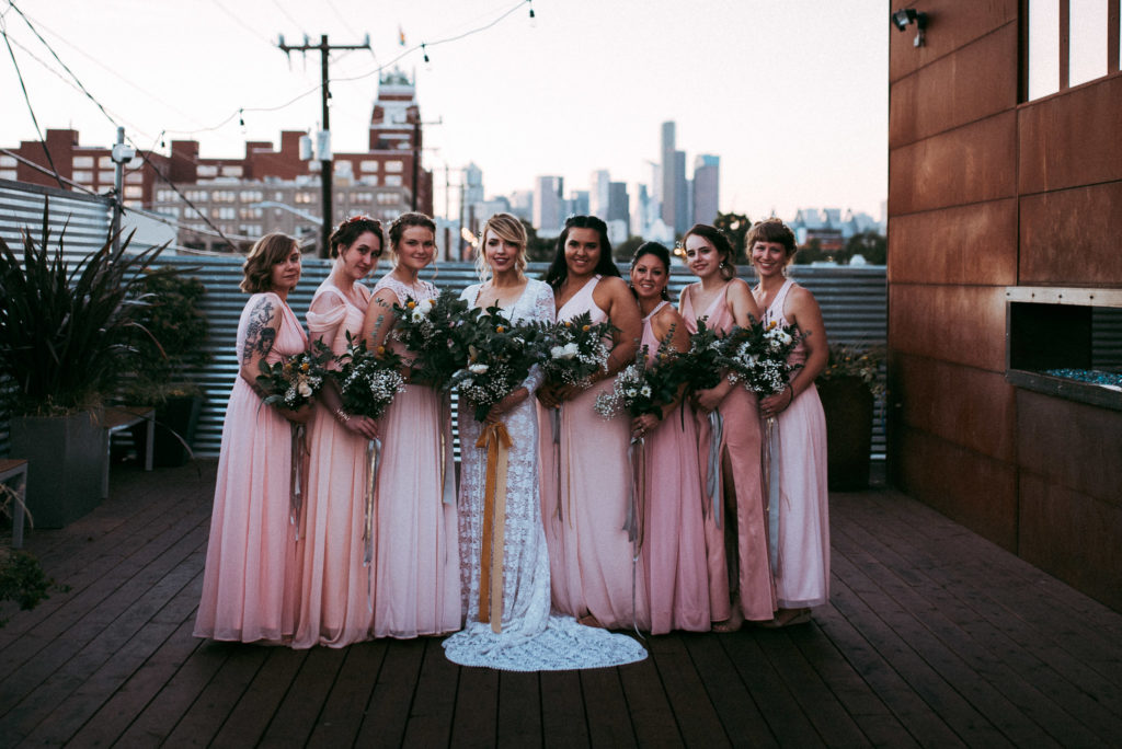 bridesmaids on roof deck at sunset seattle skyline withinsodo wedding