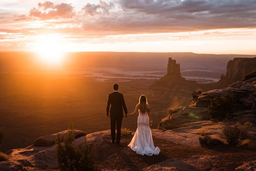 elopement couple watching sunset in Utah