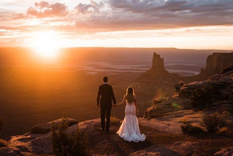 elopement couple watching sunset in Utah