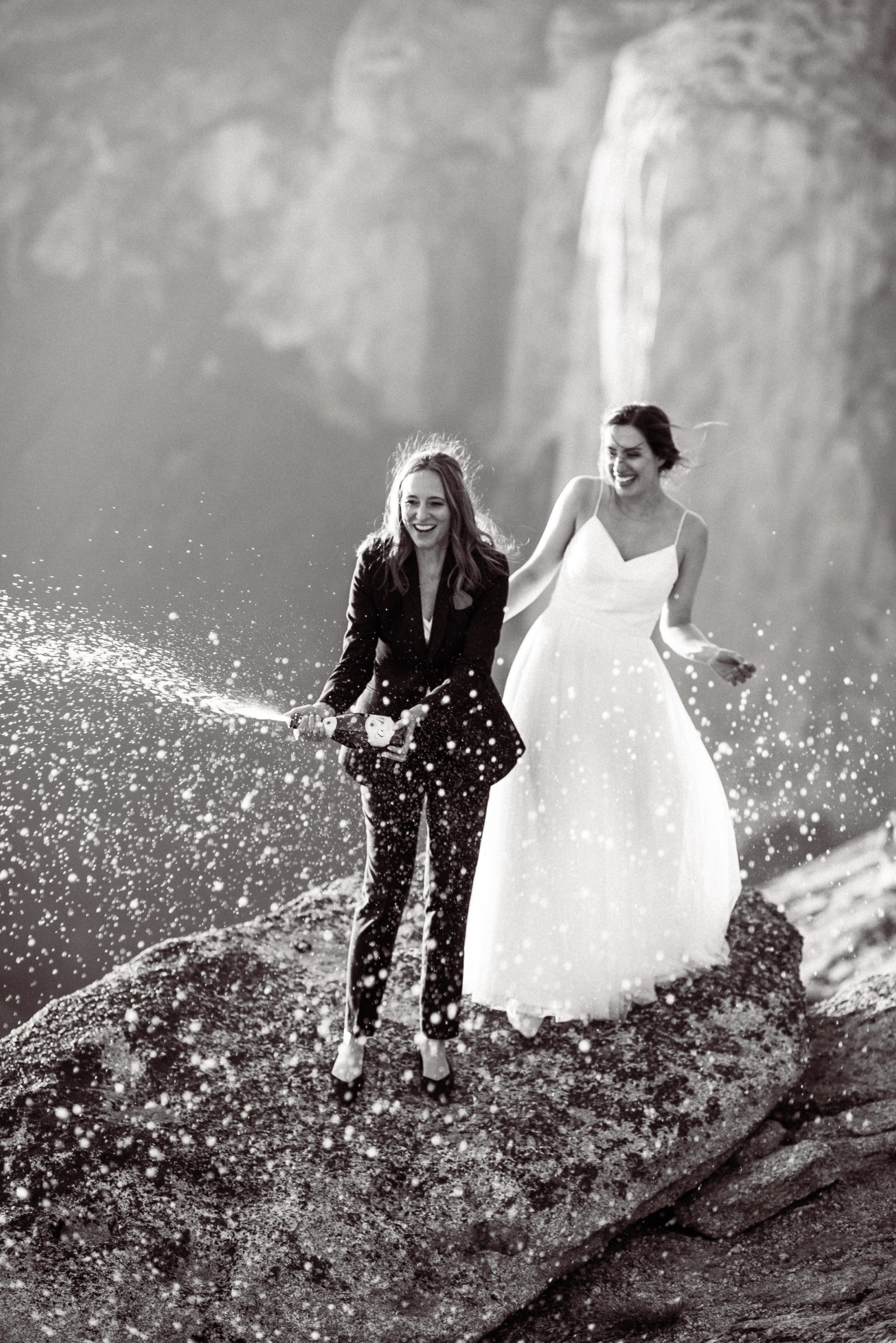 yosemite elopement with two brides popping champagne