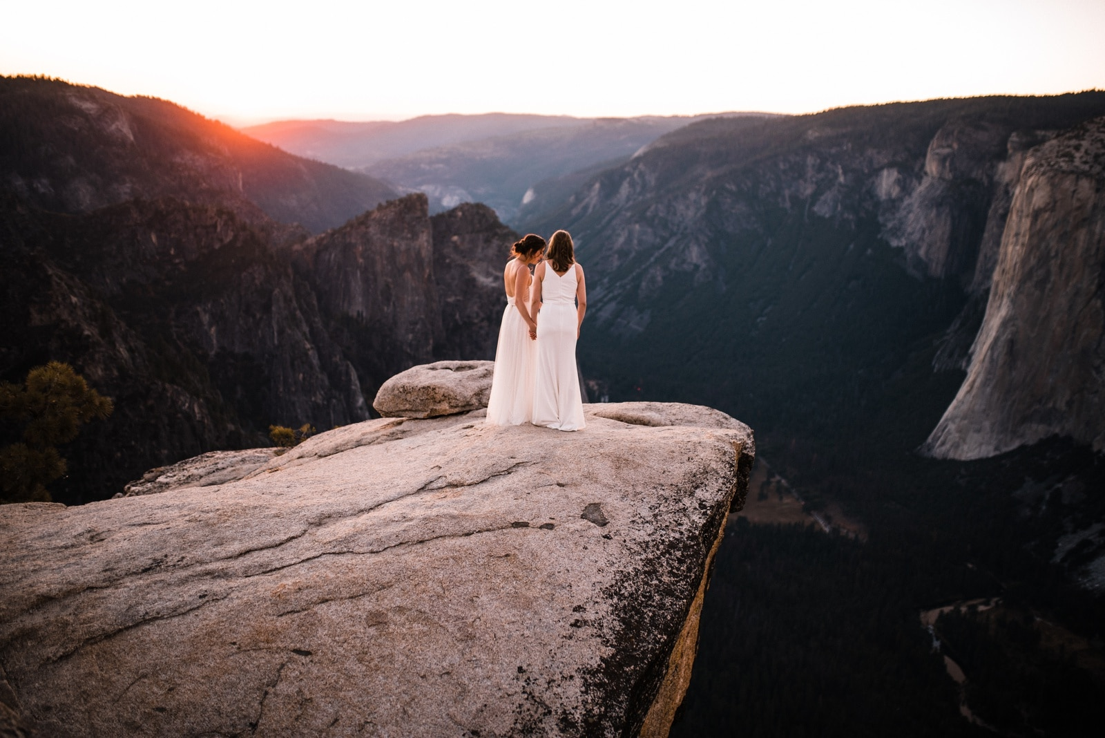 Wedding couple on Taft Point at Sunset Yosemite Elopement