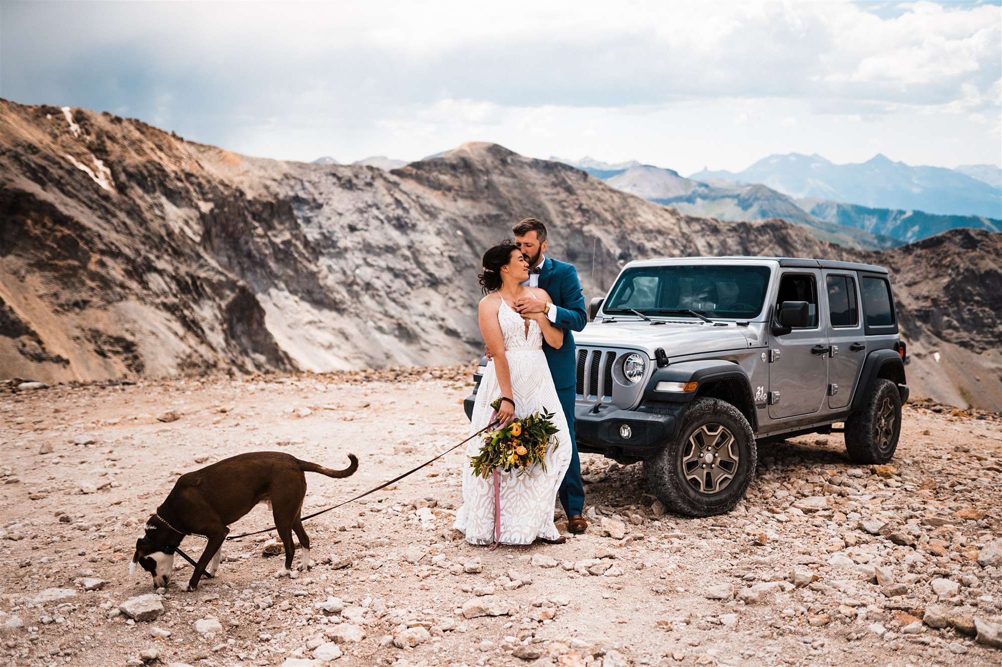 Telluride elopement couple standing by jeep with dog