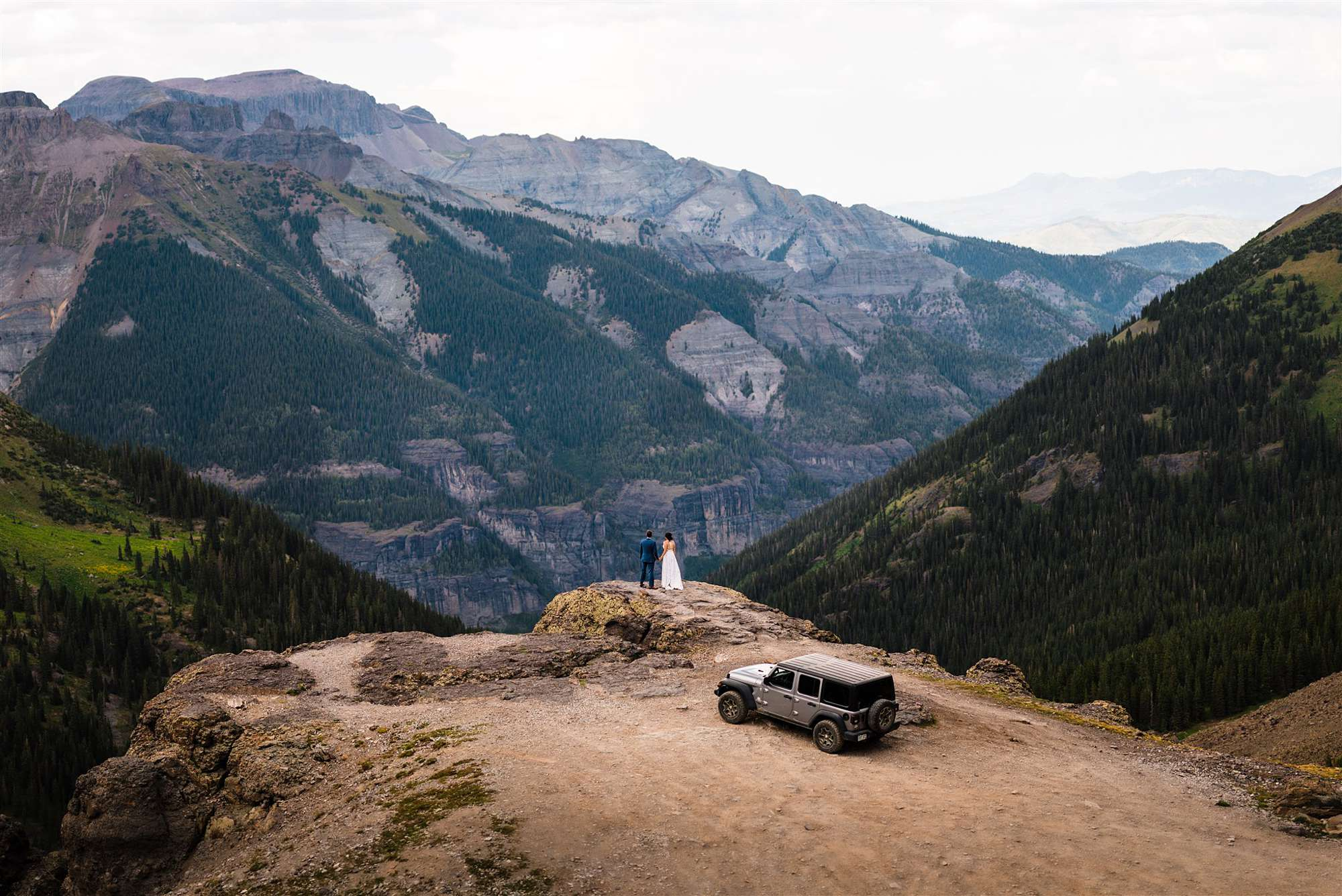 Elopement couple standing by jeep in colorado