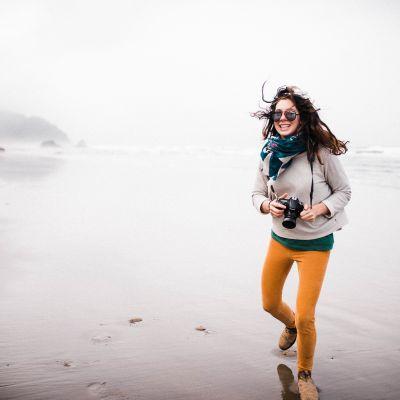 girl laughing wind blowing hair on beach hug point oregon coast