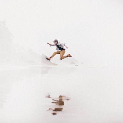 boy jumping on oregon coast beach at Hug Point
