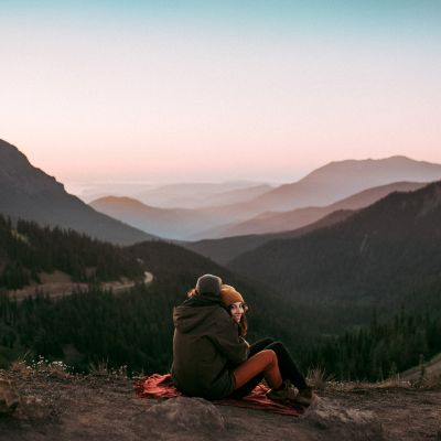 Brandon and Gabi Fox, Adventure Wedding photographers, during sunrise at Hurricane Ridge in Olympic National Park.