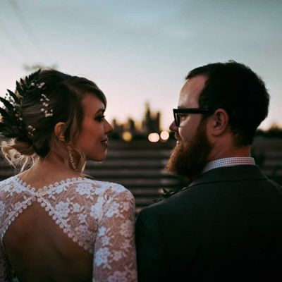 bride and groom looking at each other on roof deck withinsodo seattle wedding
